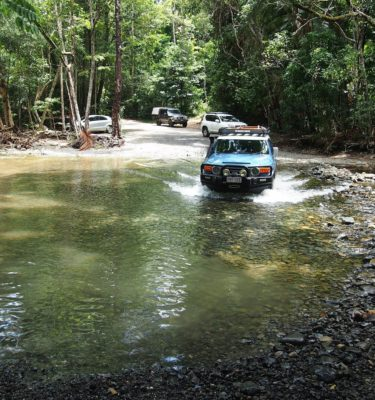 Experience off-road adventures including creek crossings on Cooktown tour