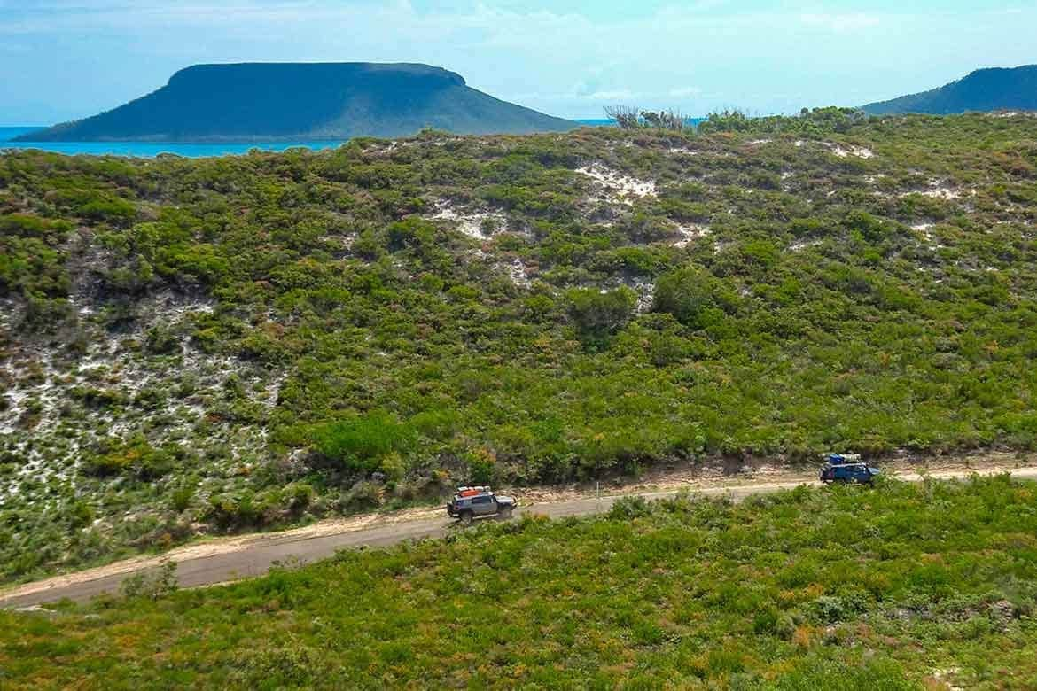 Explore Cape Bedford via Cape Tribulation, Bloomfield Falls, the Lion's Den, Cooktown and Laura Homestead